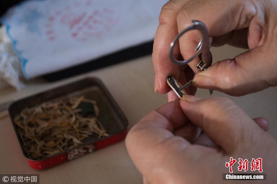 大妈用瓜子壳做出13米长清明上河图 - 周公乐 - xinhua8848 的博客