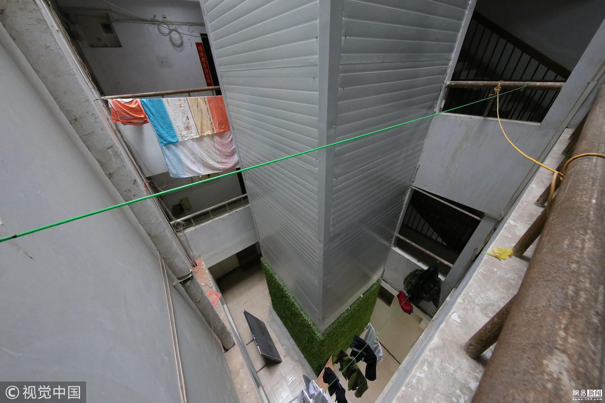 老楼住户花20多万加装电梯 按楼层分摊费用