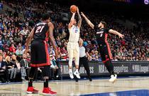 NBA常规赛:热火97-103负76人